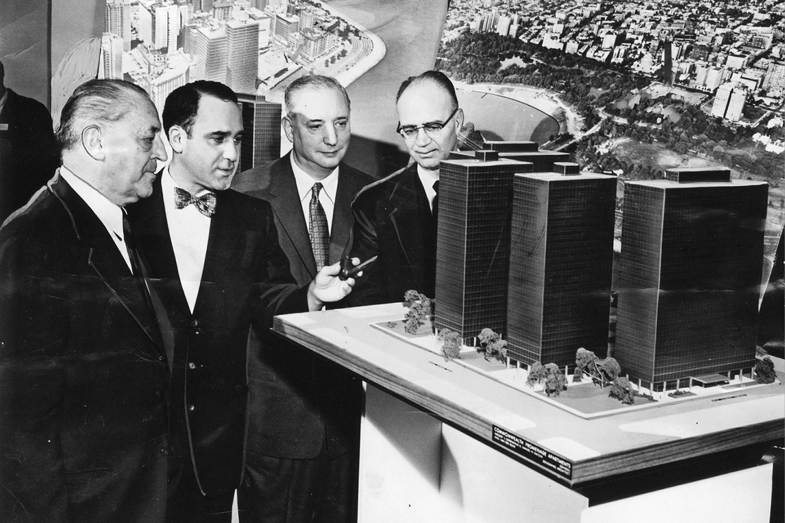 "Model of Commonwealth Promenade, Chicago. Left to right are Mies van der Rohe, Herbert Greenwald, Samuel Katzin, and Maurice Nelson. ""Six Apartment Buildings Set on Northside,"" Chicago Tribune, March 15, 1955, B7. © Chicago Tribune. All rights reserved. Used by permission."