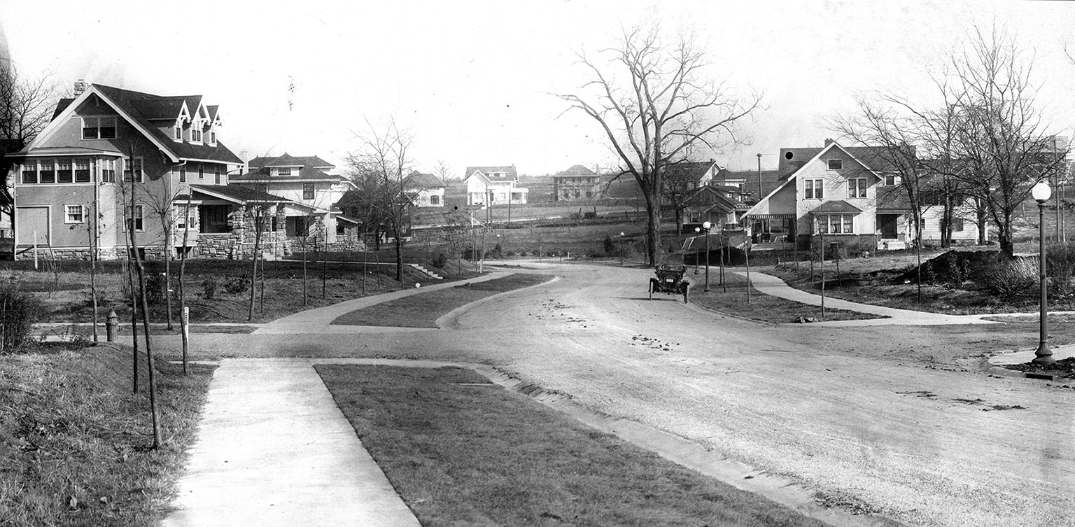 Curved vistas in the Country Club District, Huntington Road, Kansas City, Missouri, September 1913. J. C. Nichols Company Scrapbooks (K0054-00660), The State Historical Society of Missouri, Photograph Collection.