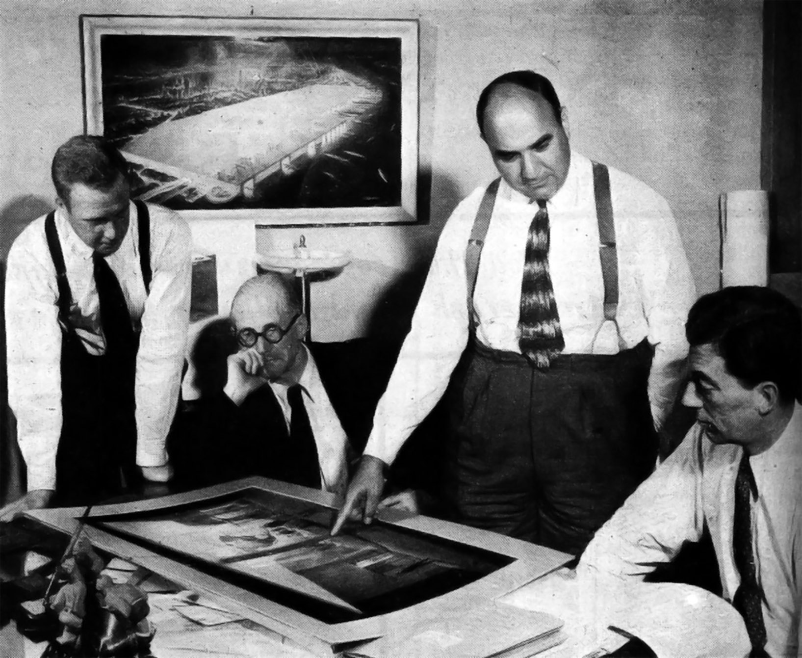 "Photograph of Le Corbusier (in jacket) with William Zeckendorf (pointing) and Webb & Knapp associates. ""Real Estate Dynamo,"" Business Week, August 16, 1947, 28."
