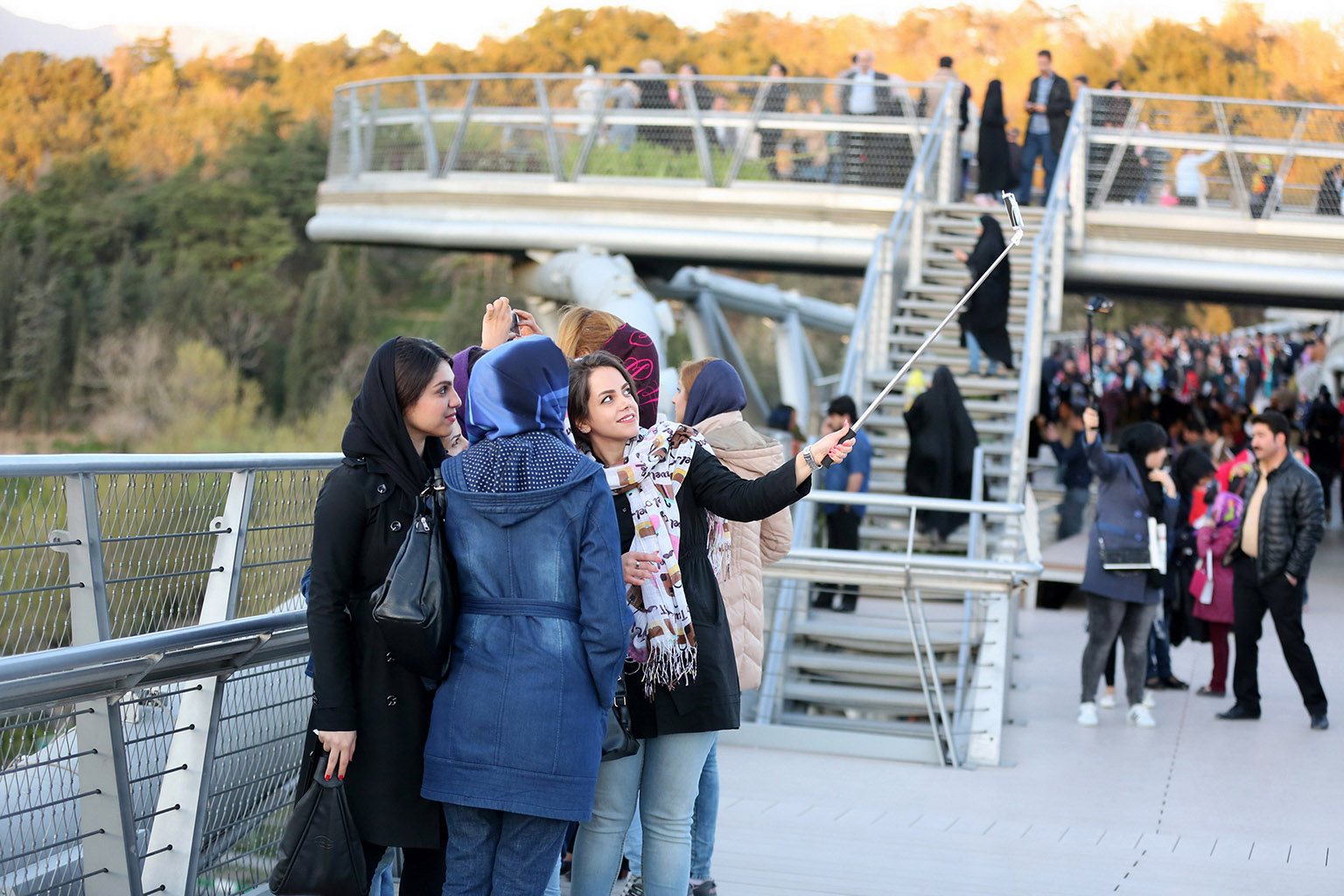 Iranian teenage girls posing for a selfie on the Tabiat Bridge.